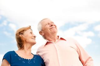older white couple gazing at sky I dentures at cook family dental