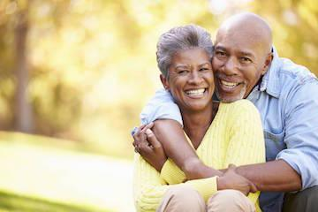 black older couple hugging I dental implants cook family dentistry