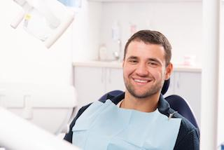 man sitting in dental exam chair I root canal at cook family dental