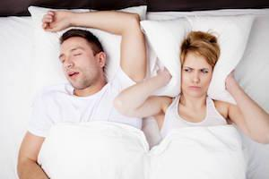 young white couple sleeping I silent nite sleep appliance