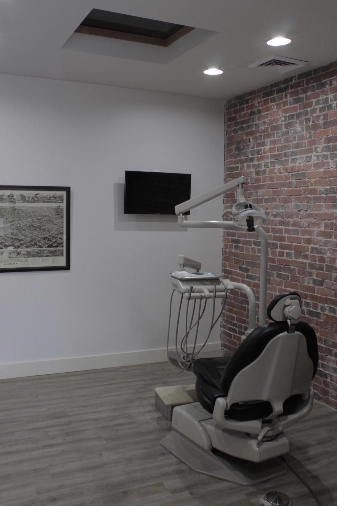 The Office Exam Room with a TV in Birmingham, AL at Cook Family Dental